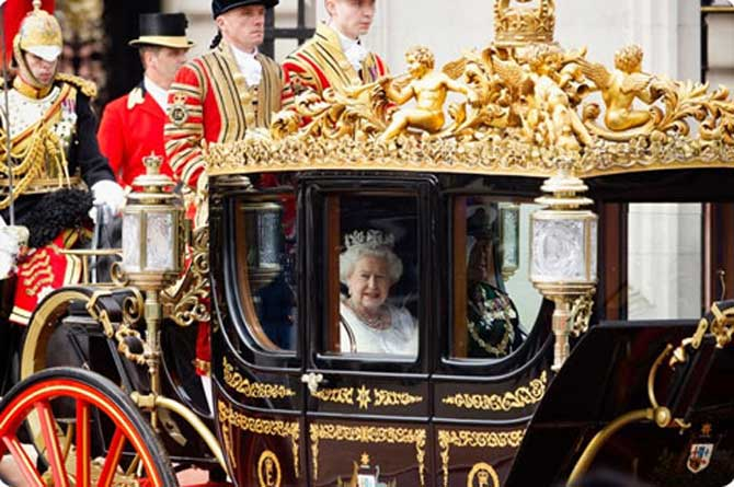 The Queen enroute to the Palace of Westminster in a hrose drawn carriage