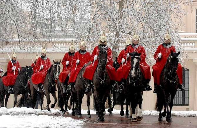 Life Gurds riding in the snow to Horse Guards