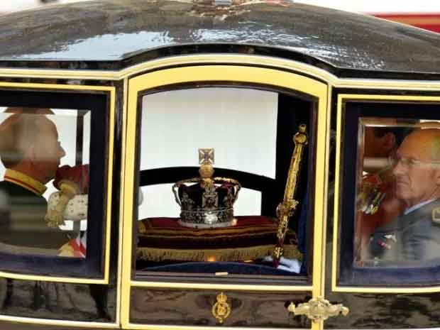 Queen's Regalia is carried by coach to the Palace of Westminster