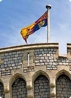 Royal Standard flying over the Round Tower at Windsor Castle signifies Thw Queen is in residence