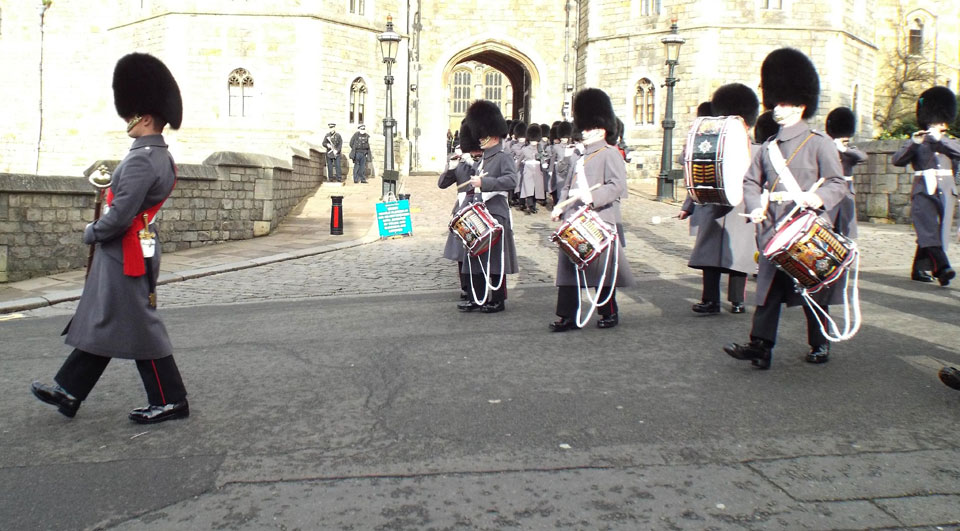 Old Guard leave Windsor Castle led by 1st Bn. Irish Guards Corps of Drums