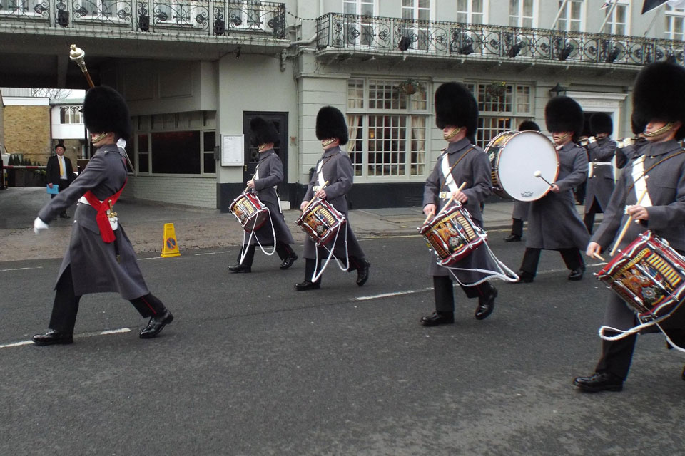 1st Bn.Irish Guards Corps of Drums march up the High Street