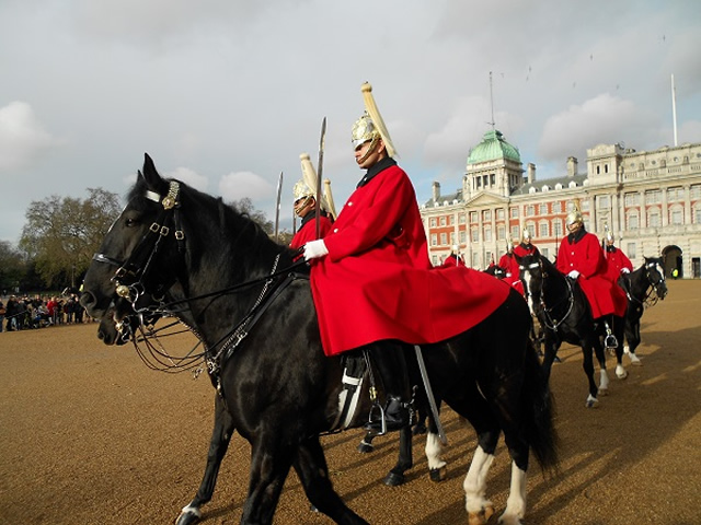 The Life Guards ride onto Horse Guards Parade