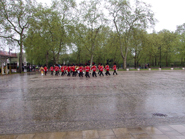 Band of the Coldstream Guards return leaving the Guards to march in silent mode through the rain