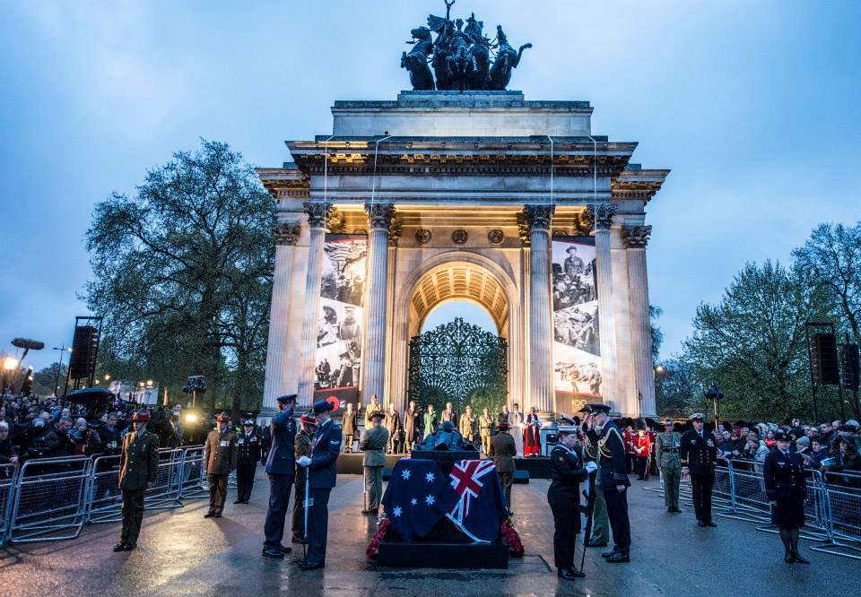 Wellington Arch  draped with banners illustrating  scenes and  personalities from the Gallipoli Campaign