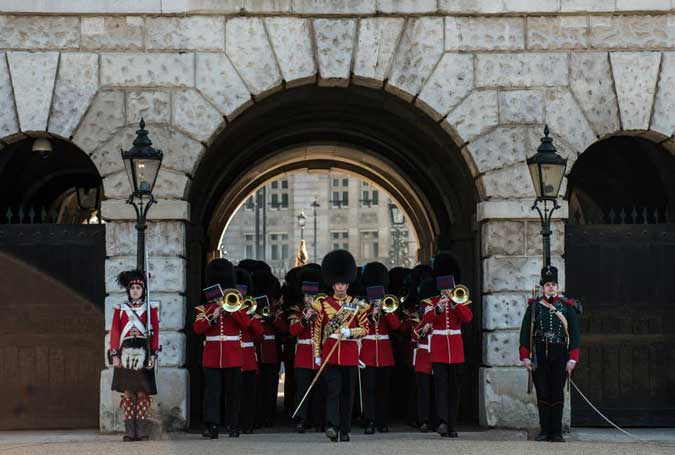 Band of the Irish Guards march through Horse Guards Arch
