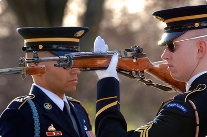 Relief Commander inspects sentries weapon at The Tomb Of The Unknown Soldier