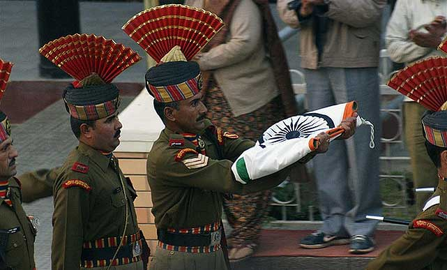 Soldiers march back with the Flag of India
